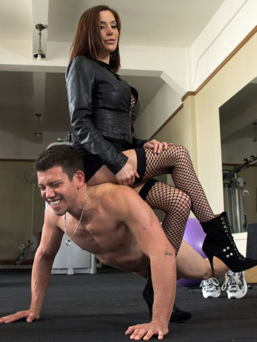 Gia DiMarco getting her feet and slit licked by her slave after she punishes him in kinky femdom.