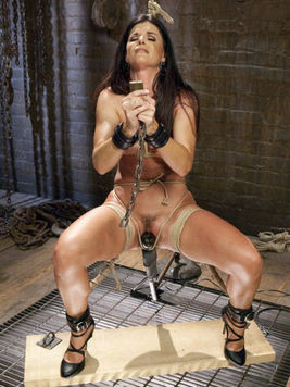 After dark haired India Summer is strapped up and tied her face and holes get stretched in BDSM.