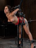 Sexy bodied latina Jynx Maze gets caned and finger fucked in metal restraints