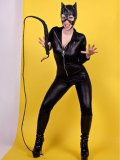 Cat woman Lynn Pops with a whip unzips her tight black body suit to show her breasts