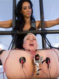 Isis Love stimulates blonde Lorelei Lee with electricity and all kinds of fetish and kinky toys.