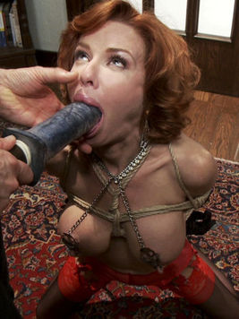 Fetish gal Veronica Avluv in on her knees,  tied up and getting her mouth fucked with plastic.