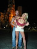 Leggy blonde Chantal in white mini skirt flashes her private parts in the night street