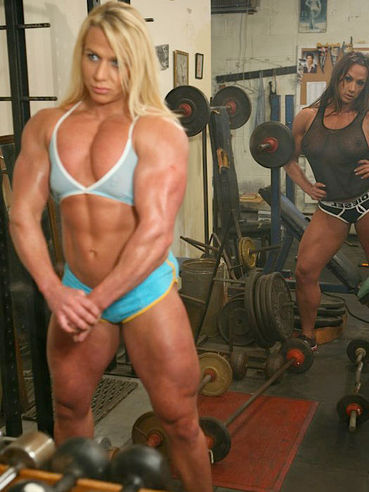 Lez bodybuilders Amber Deluca and Saskia Salemink strip naked and make out at the gym