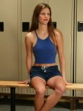 Sportsgirl Alison in uniform gets her pussy out to masturbate in the locker room