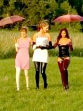 Salma de Nora and two more latex lesbians have fun in the open air on a rubber blanket