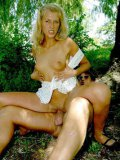 Sandy Sunshine shows her pussy in the street and gets banged in the shadow of a tree