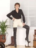 Lady Sonia in high boots holding a whip prepared to punish any fetish loving slave they give her.