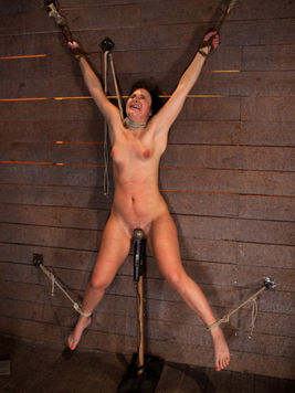 Tricked into bondage Ashli Orion is tied to a wall while getting pinched and stimulated.