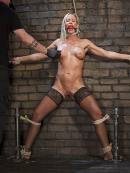 Simone Sonay tied up and dripping wet during hardcore and kinky bondage with ropes.