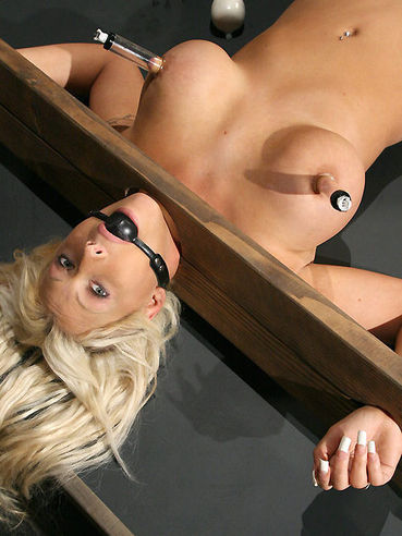 Perfect boobed restrained blonde Candy Manson gets her nipples tortured and her shaved cunt  toyed