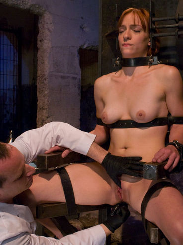 Helpless Renee Broadway gets enema punishment in black metal bondage chair