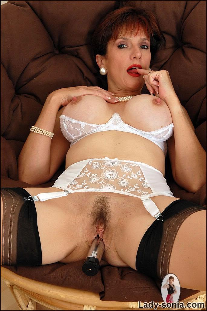Horny lady with a dildo