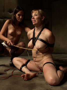 Fetish babe Amber Rayne and hot chick Adrianna Nicole playing with nipple clasps and electricity.