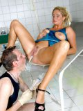 Middle aged blonde Caro in black shoes spreads her legs for enema injection