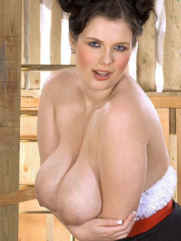 Elegant dark haired woman Deborah Blue bares her enormously big breasts for you