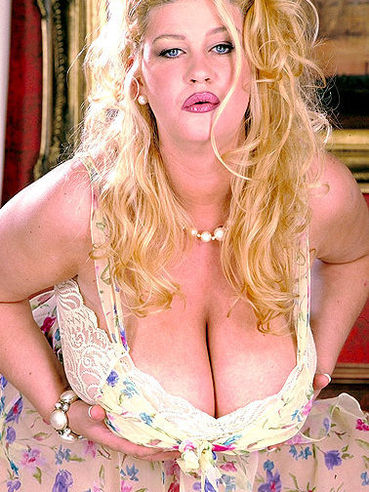 Thick blonde Gaynor in dress, panties and black shoes flashes her hairy snatch