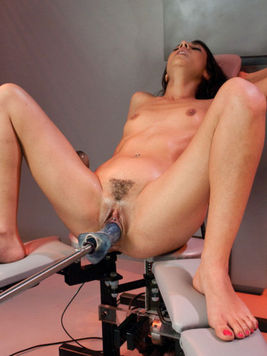 Attractive brunette Lou Charmelle gets her tight asshole fucked with the machine and she loves it.