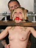 Skinny ball gagged bound blonde Faye Runaway gets her nipps clamped and her bare pussy vibed