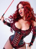 Sexy dressed Bianca Beauchamp in ultra tight latex corset shows off her giant boobs