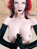 Alt model Szandora in long black latex gloves shows off her big pierced tits and clean pussy
