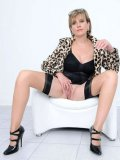 Aged model Lady Sonia in stockings and heels shows off her completely smooth pussy