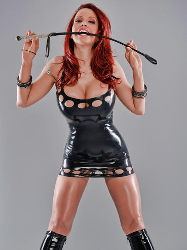 Adorable busty mistress Bianca Beauchamp poses in black latex boots and tight short dress