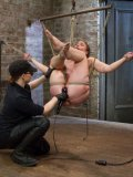 Amazing redhead Jodie Taylor is hanging tied up as her wet pussy is getting stimulated with a toy.