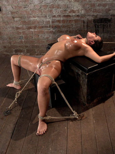 Oily babe Trina Michaels shows off her tanned melons and enjoys being tied up properly.