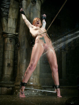 Scarlett Pain pushed to the ground, tightly bound and getting pleasured with kinky aquaphilia.