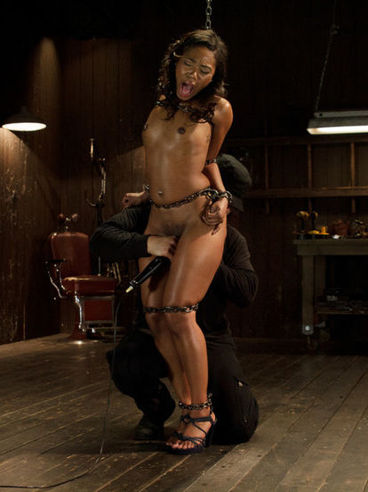 Ebony babe Chanell Heart gets pegged and tied up while rammed with sex toys during bondage.