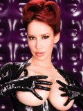 Redhead Bianca Beauchamp dressed in black latex gets her big jugs out and touches them