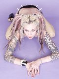 Tattooed tight alt blonde Voltaire poses naked in black platform high heels