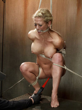Blonde bondage whore Cherie DeVille hogtied and stimulated with ropes by her kinky bdsm master.