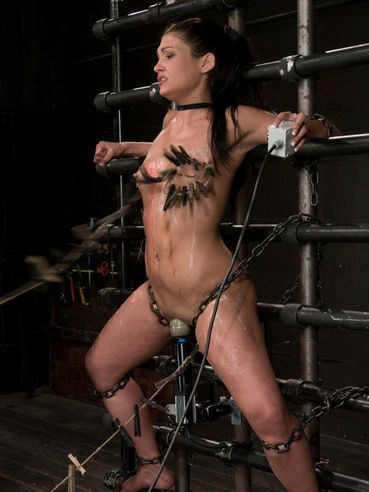 Jade Indica spread wide open with chains and getting her shaved slit vibrated during bondage.