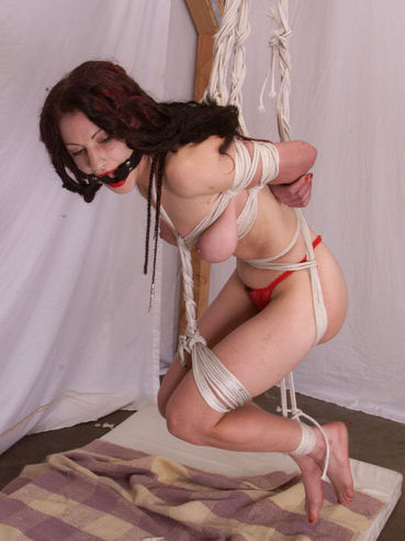 Long haired breasty slave woman Vanity getting handcuffed and rope bound