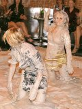 Tatiana Milovani takes part in amazing mud wrestling match at the party