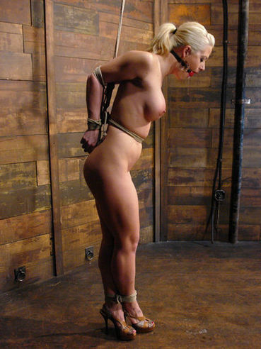Busty rope tied blonde Holly Heart gets oiled up and tortured with clothespins by Maestro