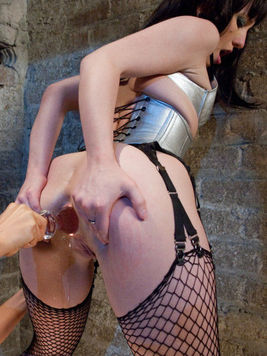 Hairy Isis Love wearing slutty fishnets gets her ass double fisted by the wicked Proxy Paige.