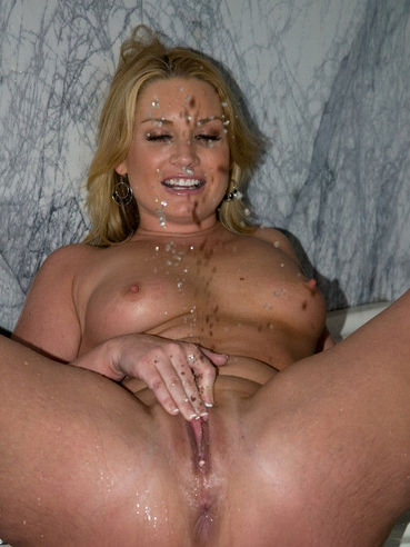 Pretty blonde milf Flower Tucci with big ass strokes her wet cunt and squirts while sucking a dick.