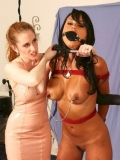 Bound girl Mariah Milano is staying in doggy and getting holes strapon fucked by Natali Demore.