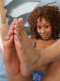 Curly haired chocolate chick Misty Stone exposes her fine feet and gets hardcored
