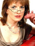 Elegant middle-aged woman Lady Sonia in stockings and skirt licks boy's dick