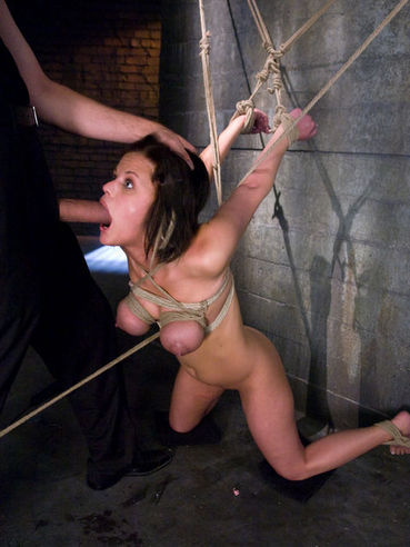 Big titted bondage babe Nikki Grind gets her pussy pumped full of Steve Holmes fat cock