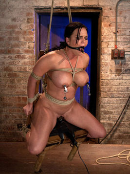 Lustful brunette Mackenzee Pierce gets gagged, her huge tits pinched and her clit teased.