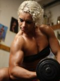 Blonde Mihaela Radu in red panties and black top admires her muscles during workout