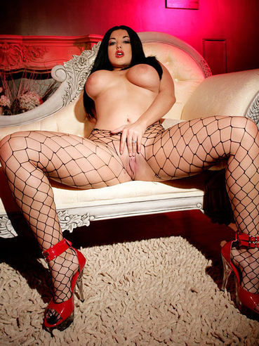 Big racked gothic brunette Jemstone in fishnet pantyhose takes off her red corset