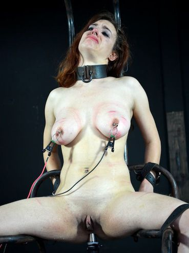 Naked shaved pussy brunette Iona Grace gets her big tits tortured in the dungeon