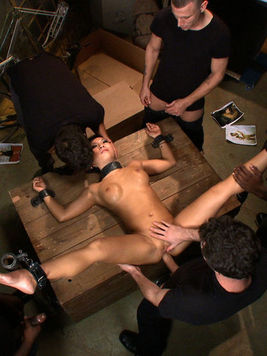 Asian star Asa Akira is placed in bondage and gets rough fucked by a platoon of dudes