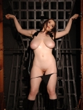 Curvy well-endowed BDSM model Anna Song strips off her tight leather dress and panties